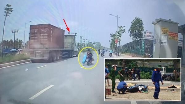 Hà Nội: CLIP cận cảnh sang đường, 2 người trên xe máy bị container tông tử vong